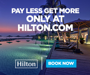 Hilton -Pay Less Sign