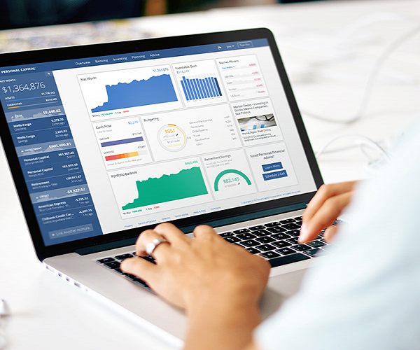 woman viewing personal capital financial dashboard on her laptop
